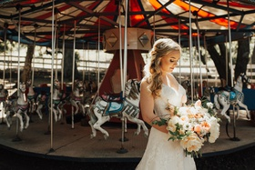 bride in lace stella york gown carrying large bridal bouquet