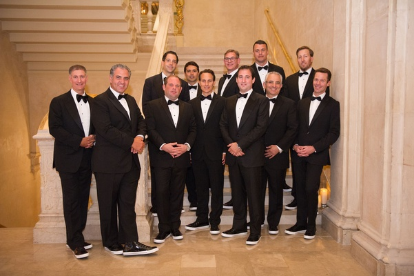 Groom and groomsman groomsmen family with bow ties and patent leather sneakers for shoes