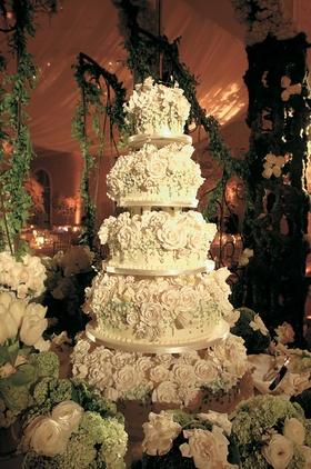 Large wedding cake covered with white sugar roses
