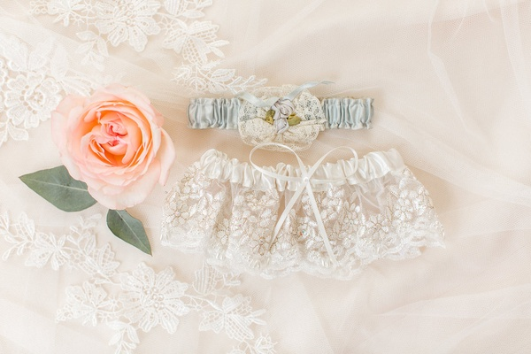 Wedding garters on lace veil white lace ribbon and light something blue garter