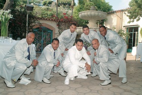 Men wearing matching tuxedos and shoes