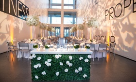 museum contemporary art reception space floral sweetheart table chicago floral bar flowers decor