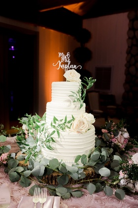 classic wedding cake with ivory roses and greenery