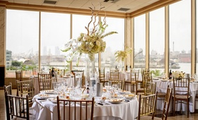 Classic wedding decor in restaurant ballroom new york brooklyn skyline city bridge