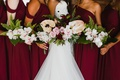 bridesmaids bouquets with ferns, orchids, tropical leaves