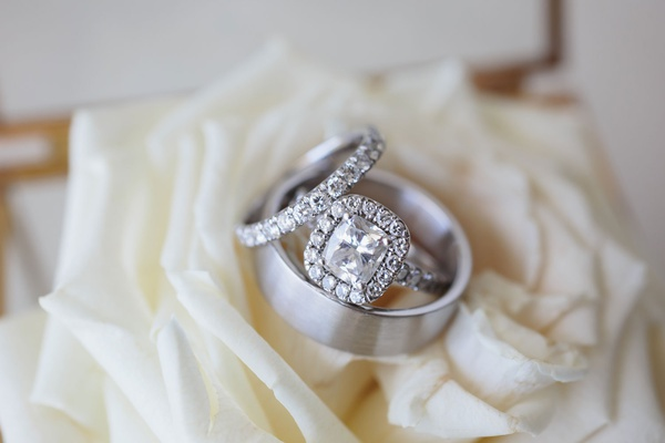 wedding rings engagement ring in halo setting matching wedding band with men's ring on white rose