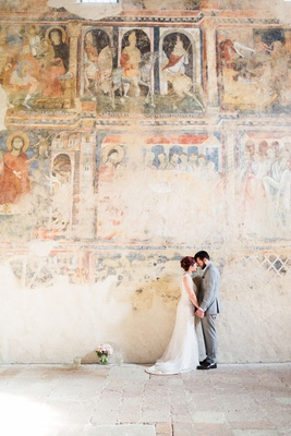destination wedding portrait bride and groom forehead touch in italy fresco paintings on walls venue