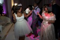 Kandi Burruss with wedding guests in short bridal gown and tiara