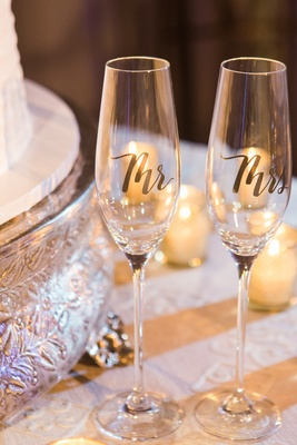champagne glasses with mr and mrs written in cursive and gold