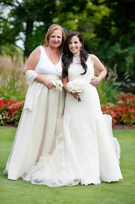 Bride in Vera Wang wedding dress with white Kate Spade mother of bride dress