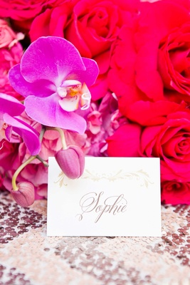 calligraphy place card vibrant flowers sophie gold metallic details pink purple wedding reception