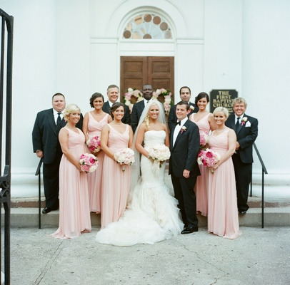 Bridesmaids and groomsmen outside church