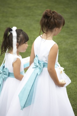 white flower girl dresses with blue ribbon bow in back