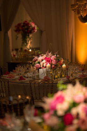 Wedding reception romantic candlelight on round table with candles and crystal glassware peony rose