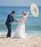 wedding portrait bride groom reaction first look parasol beach montauk east coast new york