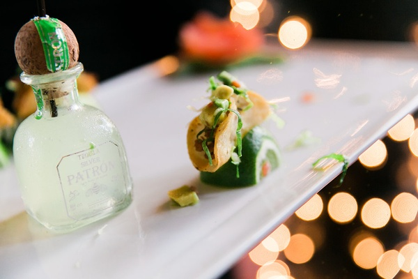 Wedding reception appetizer patron bottle and taco on top of lime