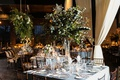 square reception table with centerpiece of only greenery