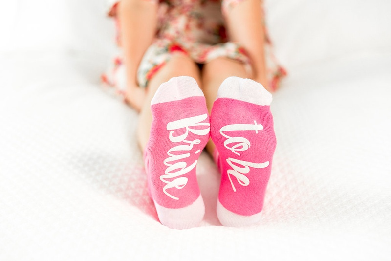 Wedding gift ideas pink and white socks for bride with bride to be on sole of foot bottom sock