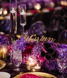 Laser cut table number sticking out of purple flowers modern calligraphy purple centerpiece ideas