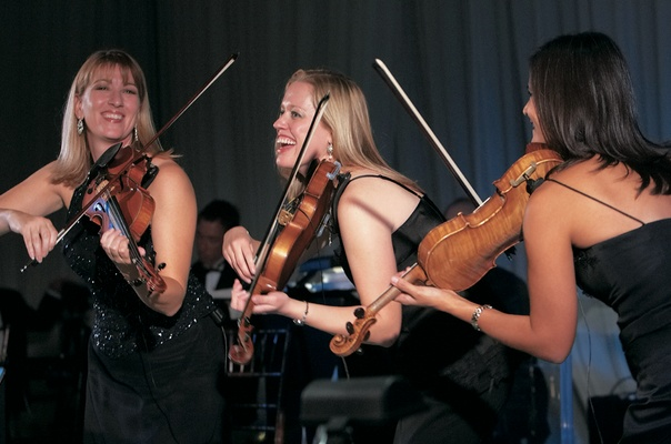 Strings players performing at reception