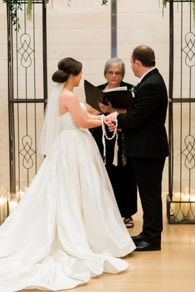 handfasting ceremony, celtic wedding tradition, bride in plain satin justin alexander ball gown