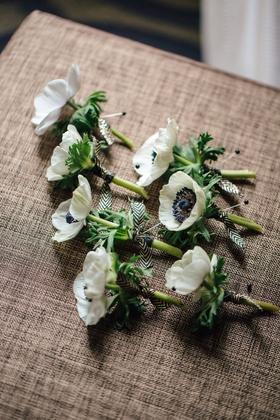 White and black anemone flower boutonniere for groomsmen chevron diamond ribbon