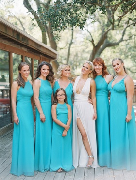Bridesmaids in long turquoise dresses with mismatched necklines flower girl junior bridesmaid Lana