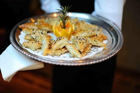 Puff pastry appetizers on silver platter