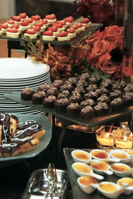 Sweet treats on glass trays at reception