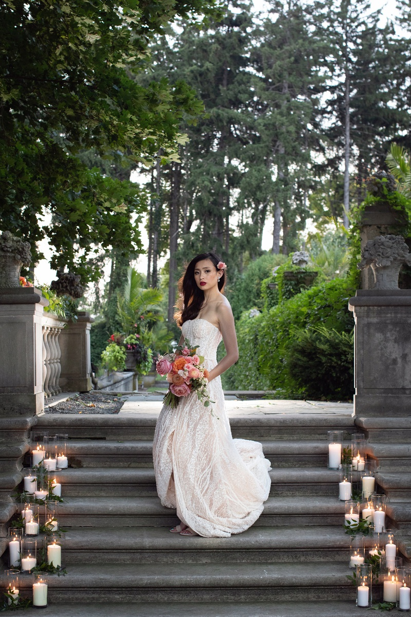 styled shoot wedding inspiration bride in mira zwillinger, peachy bouquet, candles on steps