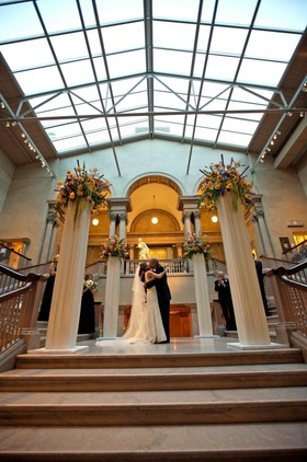 Grand staircase with window ceiling and pillars