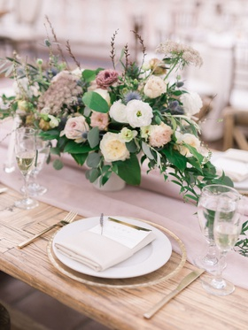 wedding reception wood tablee low centerpiece white dusty rose lavender blue greenery gold flatware