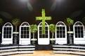 Magnolia cross and ficus trees on wedding stage