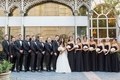 bride groom white dress black attire outfits dresses groomsmen bridesmaids white blush bouquets