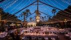 Wedding reception la quinta resort & spa outdoor wedding fairy lights in tent formation chandelier