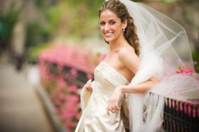 Bride in a strapless Monique Lhuillier gown and veil