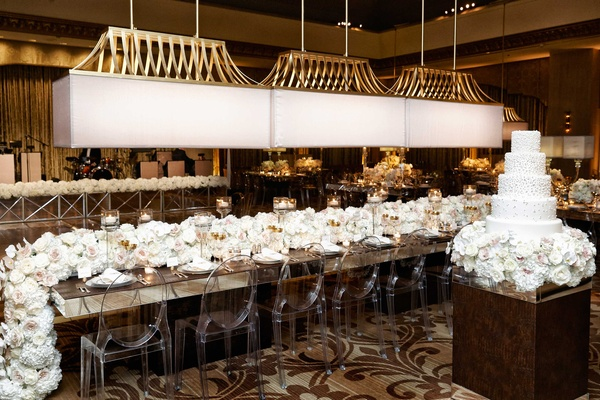 Chicago hotel wedding reception ghost chairs long overflowing white hydrangea rose orchid flowers