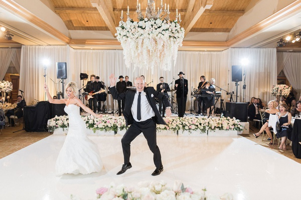bride and groom on white dance floor flower chandelier cute dance between bride and father