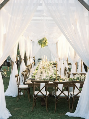 outdoor wedding reception, vineyard chairs, white and greenery, white canopy