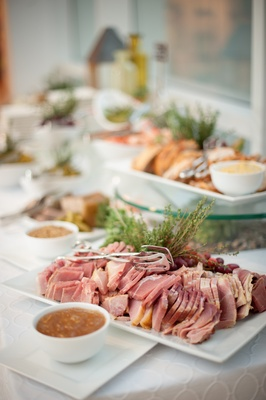 Red meat in bite-size pieces on white tray at wedding