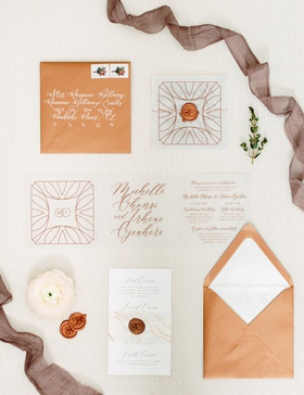 invitation suites with copper envelopes, wax seals, clear inserts