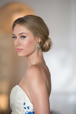 emerald drop earrings, southern-inspired wedding bride wearing updo strapless wedding dress