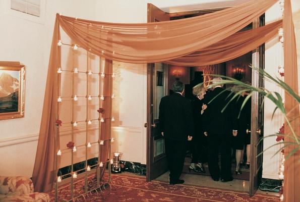 Guests walk through draped grand entrance
