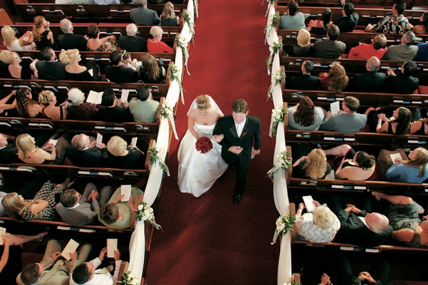 Newlyweds exit church via aisle