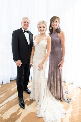 razny jewelers family wedding lace wedding dress with mother of bride in purple dress father in tux