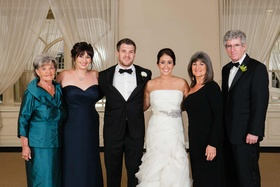 Teal jacket and asymmetrical mother-of-the-bride gown