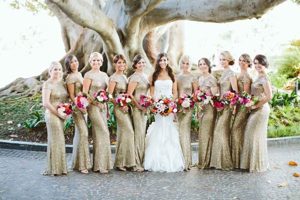bride and bridesmaids, bridesmaids wearing gold sequin dresses with colorful bouquets