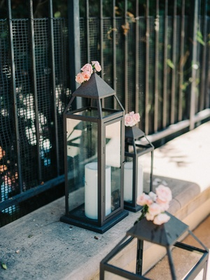 engagement party inspiration, lanterns with pillar candles and mini pink roses