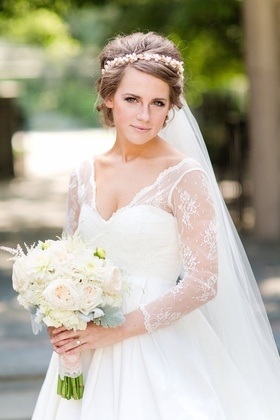 Bride wearing sweetheart neckline gown with custom lace sleeves