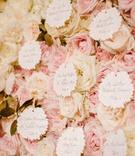 wedding escort cards flower shape with pink white rose flower wall jackson durham events